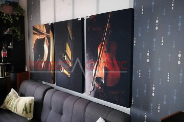 a printed acoustic panel placed on the wall in the cinema room